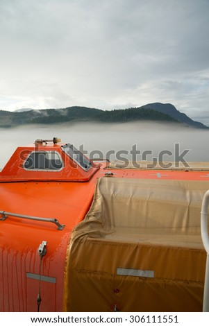 A pod designed to save 150 people is secured to a ferry boat - stock photo