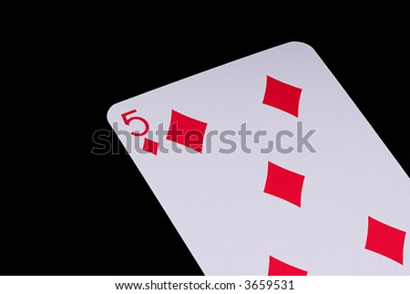 A poker card slanted view over black background