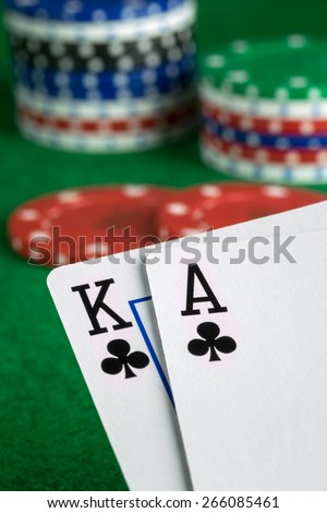 A poker hand of ace king of spades with chips in background - stock photo