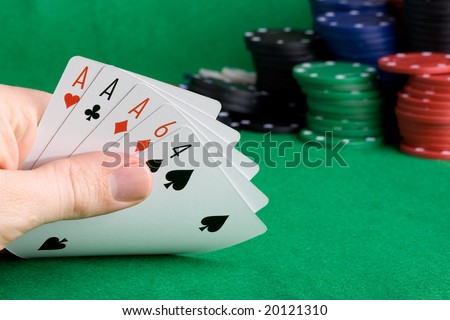 A poker hand with three of a kind Aces