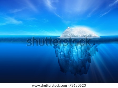 A polar bear on top of a natural iceberg glacier on the North Atlantic. - stock photo