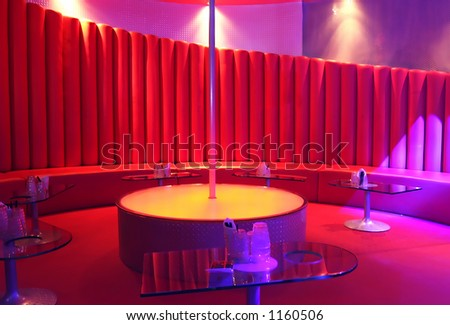 A pole in an empty night club. - stock photo