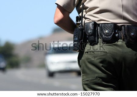 A police officer watching traffic - stock photo