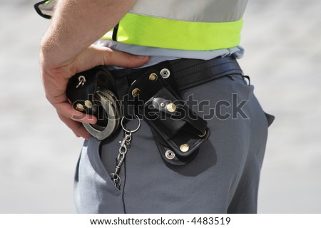 a policeman patrols on a street - stock photo