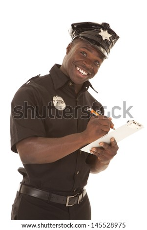 A policeman writing a ticket while smiling. - stock photo
