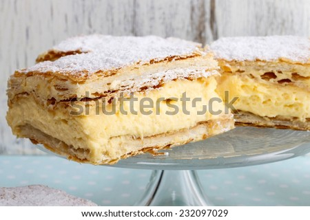 A Polish cream pie made of two layers of puff pastry, filled with whipped cream. The favourite dessert of pope John Paul II. - stock photo