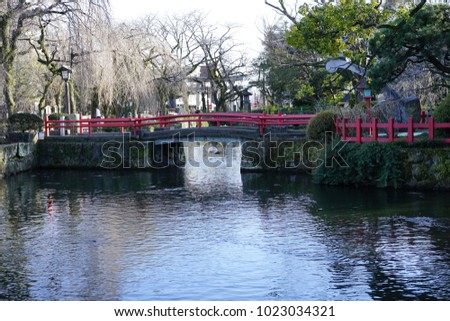 https://thumb7.shutterstock.com/display_pic_with_logo/167494286/1023034321/stock-photo-a-pond-in-a-shrine-of-shizuoka-1023034321.jpg