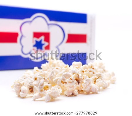 a popcorn before a box, ready to be tasted - stock photo