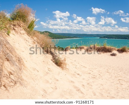 A popular dune overlooking Glen Lake at Sleeping Bear Dunes National Lakeshore. - stock photo