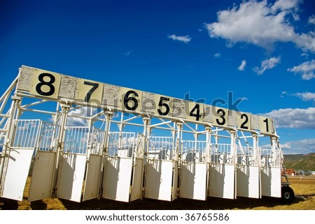 A portable horse race starting gate at the county fair. - stock photo
