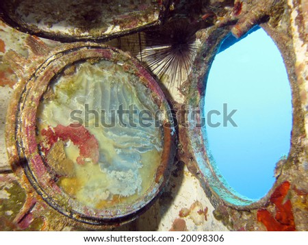 A porthole from inside a wreck. shot in the Red Sea 18/10/2008 - stock photo