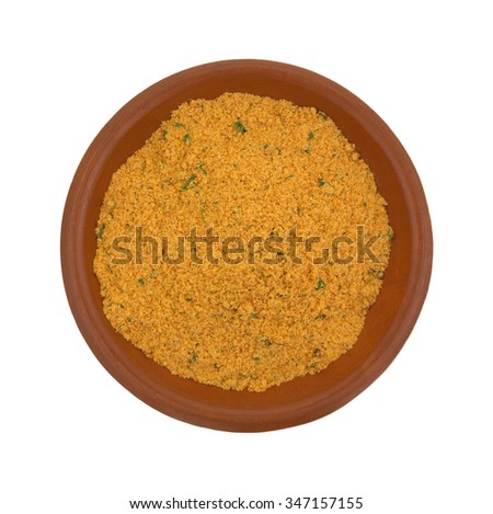 A portion of dry mesquite marinade ingredients in a small bowl isolated on a white background.
