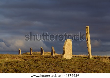 A portion of the Orkney neolithic site, the Ring of Brodgar, in evening sunlight - stock photo