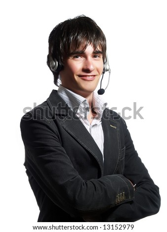 A portrait about a trendy customer service operator man who is smiling and he has a headphone. He is wearing a white shirt and a stylish black suit. - stock photo