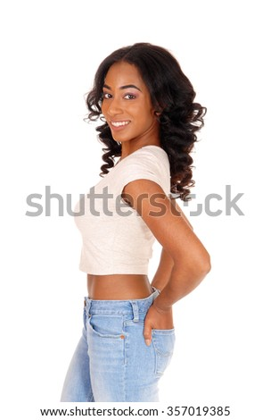 A portrait image of a African American women in a beige blouse and