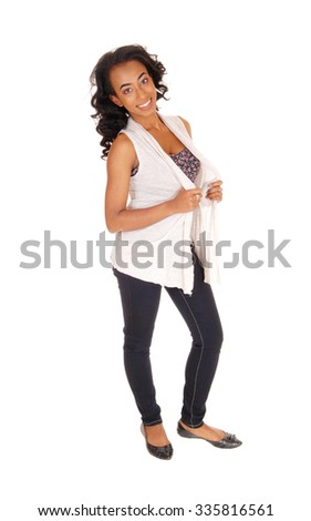 A portrait image of a african american women in a white blouse andblue jeans standing, isolated for white background. - stock photo
