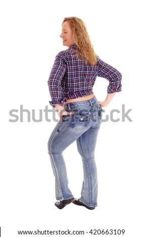 A portrait image of a blond middle age woman in jeans and a checkered