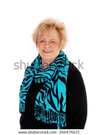 A portrait image of a blond older woman, smiling, isolated forwhite background. - stock photo