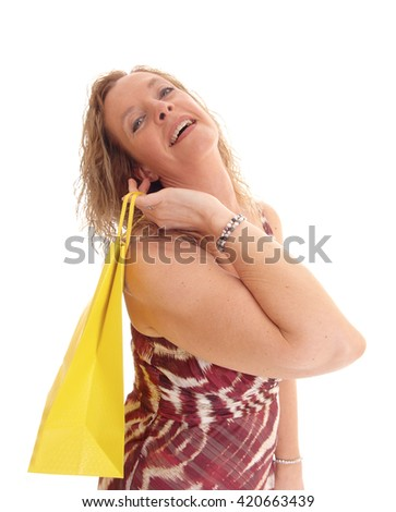 A portrait image of a blond woman in a summer dress and yellow shopping