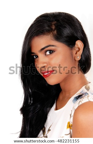 A portrait image of a lovely young Indian woman with long black hair,