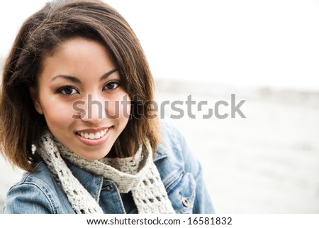 A portrait of a beautiful african american woman outdoor - stock photo