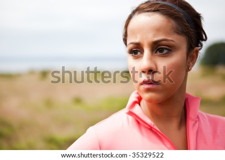 A portrait of a beautiful asian woman exercises outdoor - stock photo