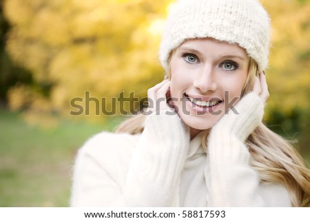 A portrait of a beautiful autumn woman outdoor - stock photo