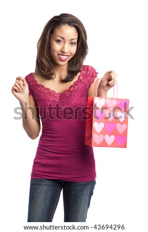 A portrait of a beautiful black valentine girl holding a valentine gift