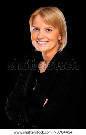 A portrait of a beautiful confident woman smiling over black background