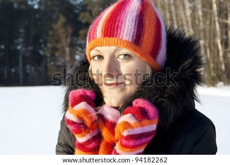 a portrait of a beautiful girl on the background of the forest in winter - stock photo