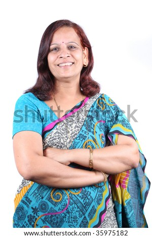 A portrait of a beautiful Indian woman in a traditional sari, on white studio background. - stock photo