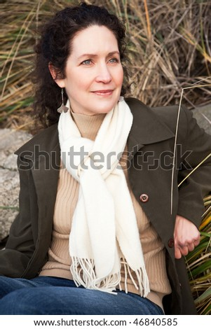 A portrait of a beautiful mature woman outdoor - stock photo