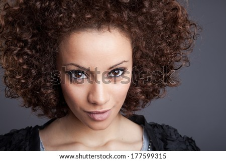 A portrait of a beautiful mixed-race woman.  - stock photo