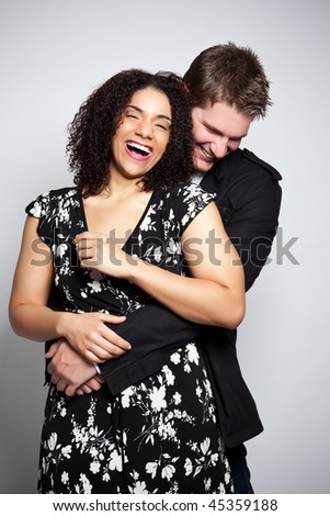 A portrait of a beautiful romantic interracial couple in love - stock photo