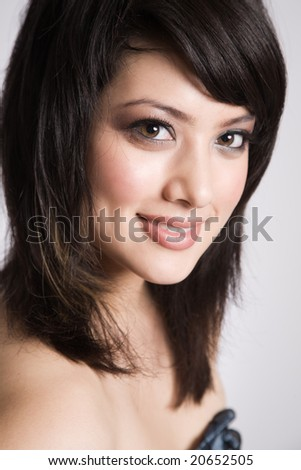 A portrait of a beautiful smiling asian girl - stock photo