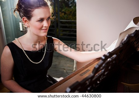 A portrait of a beautiful teenager playing piano