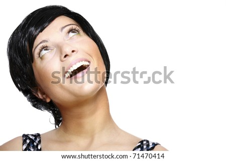 A portrait of a beautiful woman in short black hair looking up against white background - stock photo