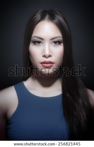 A portrait of a beautiful young asian woman - stock photo