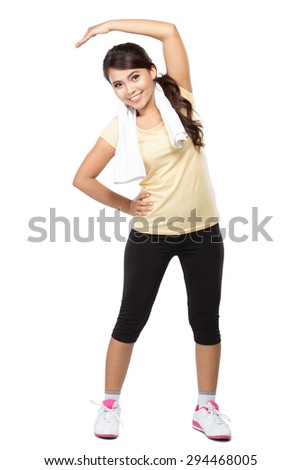 A portrait of a beautiful young asian woman doing stretching, isolated over white background