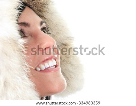 A portrait of a beautiful young woman with a winter coat in studio. - stock photo