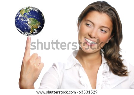 A portrait of a beautiful young woman with Earth on her finger over white background - stock photo