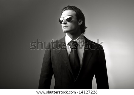 a portrait of a business man with a sun-glasses