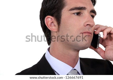 A portrait of a businessman over the phone. - stock photo