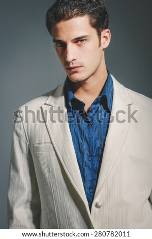 A portrait of a businessman standing isolated  - stock photo