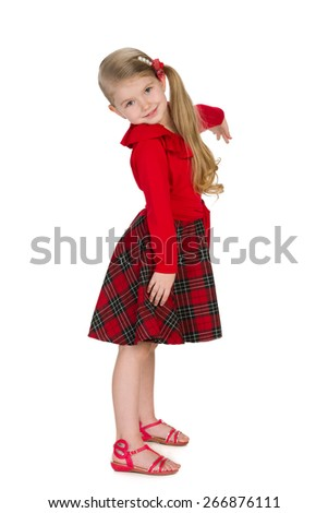 A portrait of a cheerful little girl on the white background - stock photo