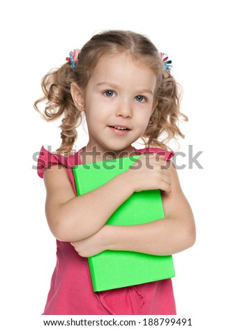 A portrait of a cheerful preschool girl with a book against the white background - stock photo