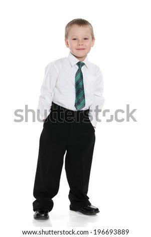 A portrait of a cheerful schoolboy against the white background - stock photo