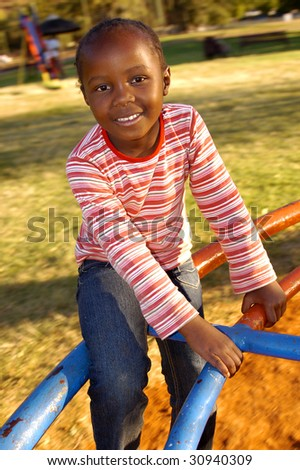 A portrait of a child in the park - stock photo