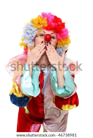 A portrait of a clown in a wig and a fancy costume - stock photo
