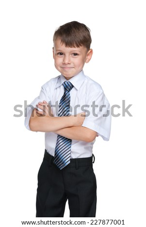 A portrait of a confident school boy on the white background